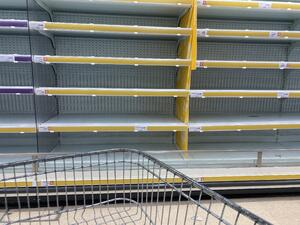 Empty supermarket shelves during panic buying in UK - March 2020